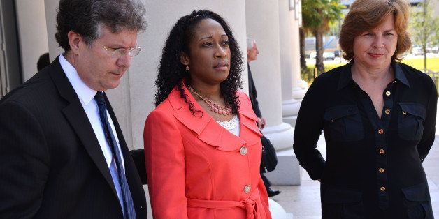 FILE - In a Tuesday, June 10, 2014 file photo, Marissa Alexander is flanked by defense co-counsel Bruce Zimet, left, and Fait