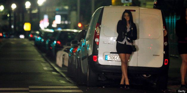 A prostitute waits for a client in a street of the French southeastern city of Nice, on March 28, 2013. France's Senate will