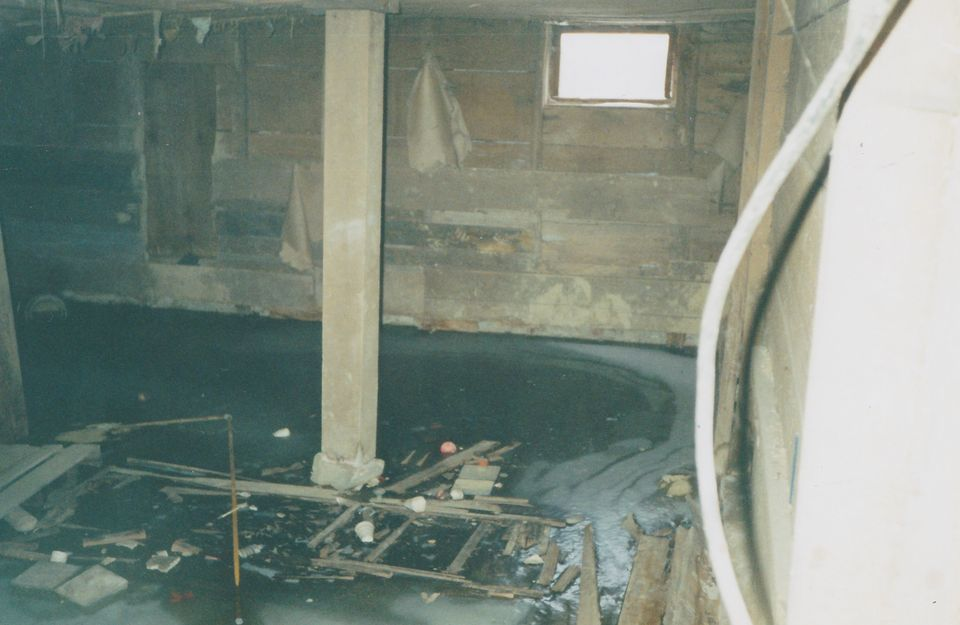 A photo of the pit, frozen over with water, as it appeared after police dug up the bodies of the Avery family.