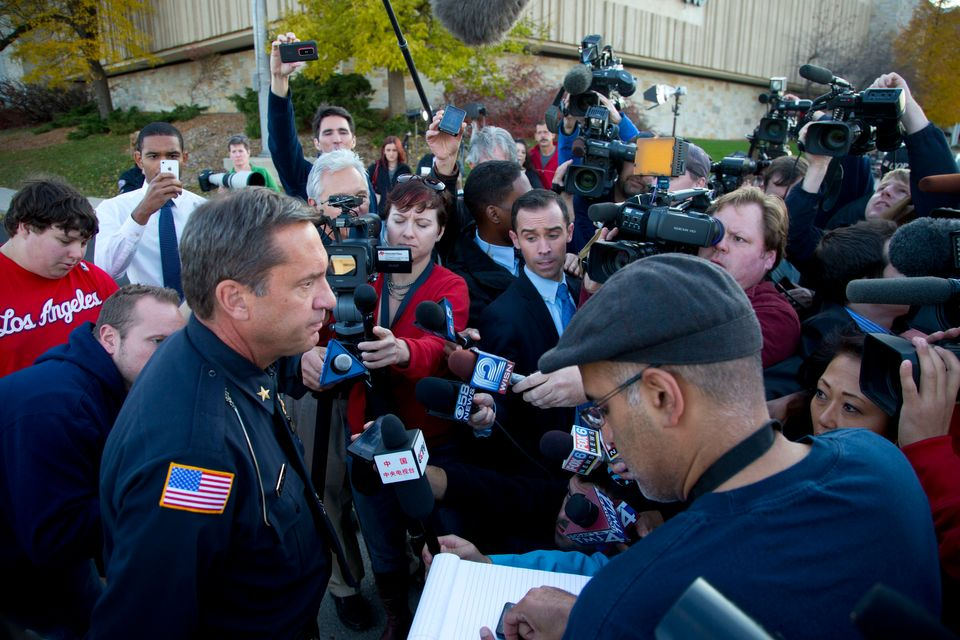 BROOKFIELD, WI - OCTOBER 21:  Brookfield Chief of Police Daniel Tushaus (L) speaks to the media near the Azana Salon and Spa