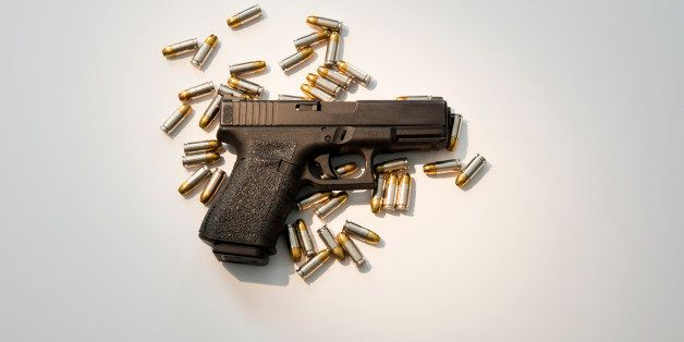 Semiautomatic handgun with high capacity magazine and live ammunition.