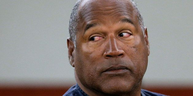 FILE - In this May 13, 2013 file photo, O.J. Simpson appears at an evidentiary hearing in Clark County District Court, in Las