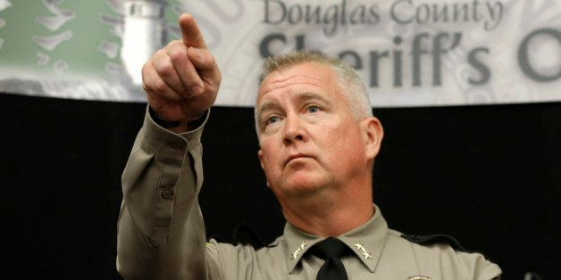 Douglas County Sheriff John Hanlin points to a reporter to take their question concerning the mass shooting at Umpqua Communi