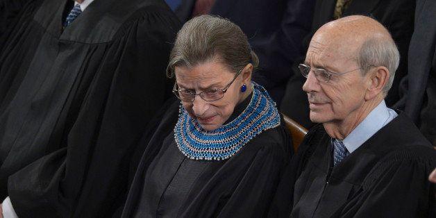 US Supreme Court Justices Ruth Bader Ginsburg (L), and Stephen Breyer (R) listen as US President Barack Obama delivers the St