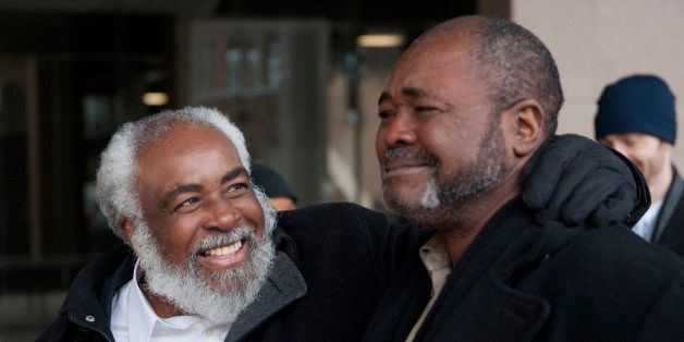 Wiley Bridgeman, 60, of Cleveland, left, is all smiles as his brother Ronnie, who is now known as Kwame Ajamu chokes up as th