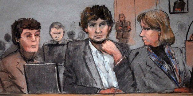 In this courtroom sketch, Dzhokhar Tsarnaev, center, is depicted between defense attorneys Miriam Conrad, left, and Judy Clar