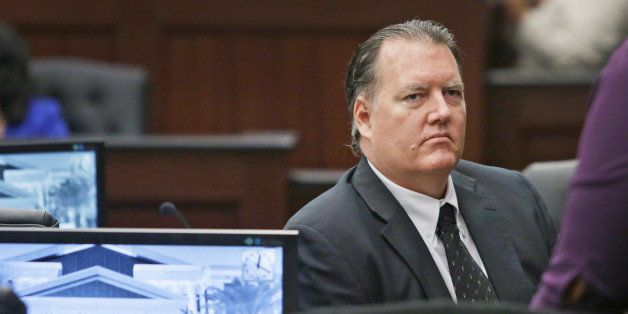 Michael Dunn sits in the courtroom as he waits for the afternoon session of his retrial to begin Friday, Sept. 26, 2014, in J