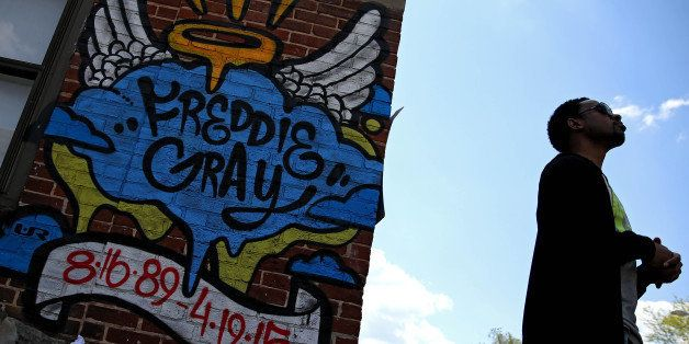 BALTIMORE, MD - MAY 03: A man looks to the sky near a Freddie Gray memorial tagging two days after Baltimore authorities rele