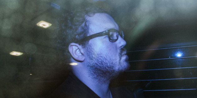 Rurik George Caton Jutting, a former Bank of America Corp. employee, leaves the Eastern Magistrates Court in a prison van in