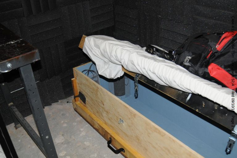 Child-sized coffin. Note the foam soundproofing on the walls