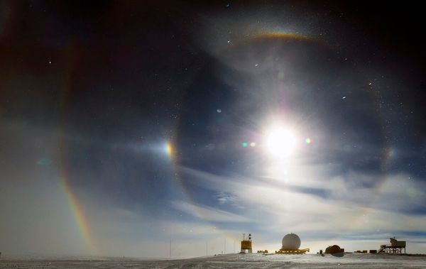 This slightly mystical effect is a sundog, also known as a parhelia or mock sun. It happens when light interacts with ice cry