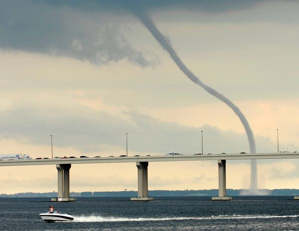 When a tornado is generated over water, this is what happens. The funnel-shaped cloud is connected to a larger cloud above. A
