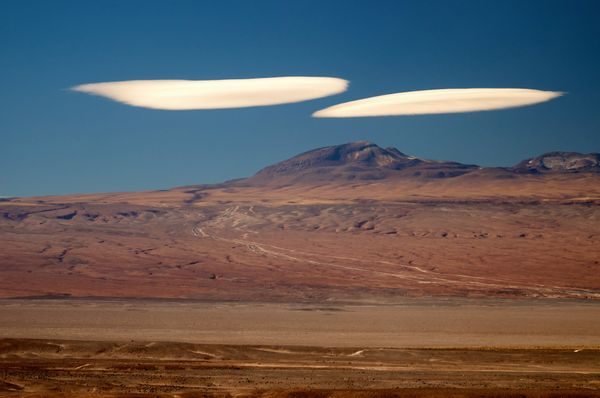 Lenticular clouds are stationary, lens-shaped cloud - but people often mistake them for UFOs as they also look rather like sa