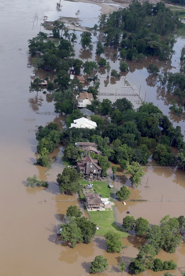 In this aerial photo, homes are surrounded by floodwaters near the San Jacinto River Saturday, May 30, 2015, in Channelview,