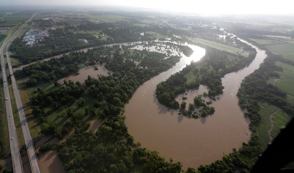 The Colorado Rivers flows out of its banks Saturday, May 30, 2015, in Wharton, Texas. The Colorado River in Wharton and the B
