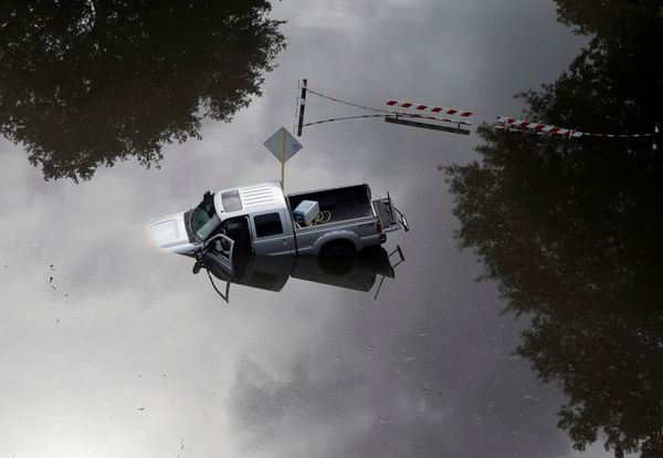 In this aerial photo, a truck sits in floodwaters near Bear Creek Park Saturday, May 30, 2015, in Houston, Texas. The Colorad