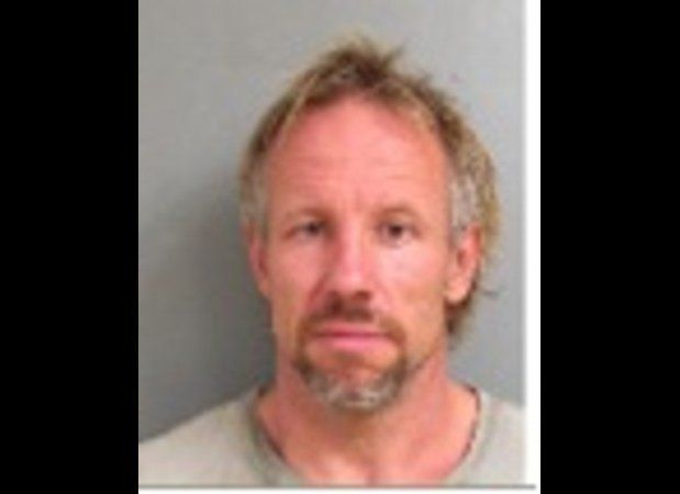 Police say that Christian Hobbs, 47, hid beneath his former Salem, New Hampshire, trailer to spy on a woman and her toddler s