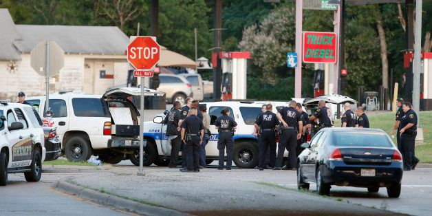 Police block the intersection of Dowdy Ferry Rd and Interstate 45 during a stand off with a gunman barricaded inside a van, S