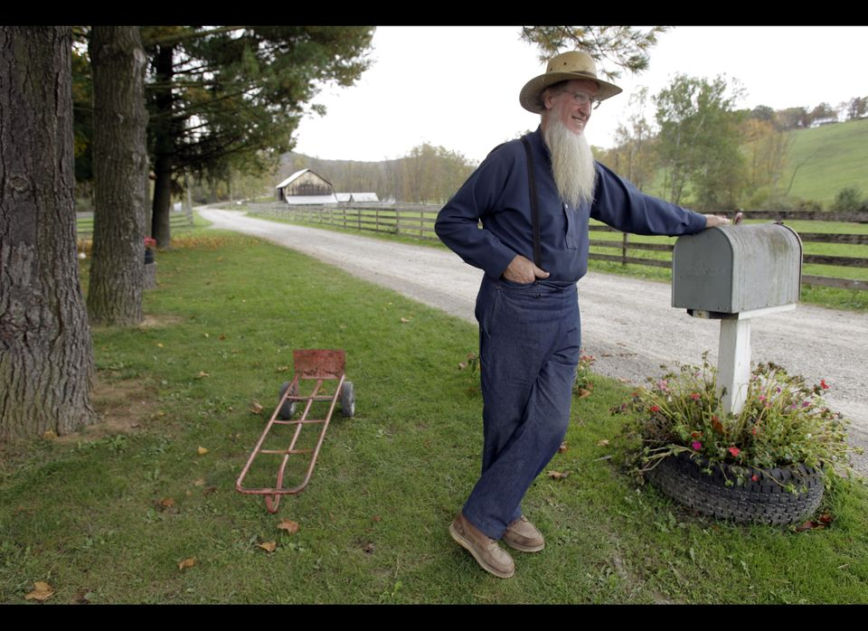FILE - In this Oct. 10, 2011 file photo, Sam Mullet leans on the mailbox at his home in Bergholz, Ohio. The FBI and local she