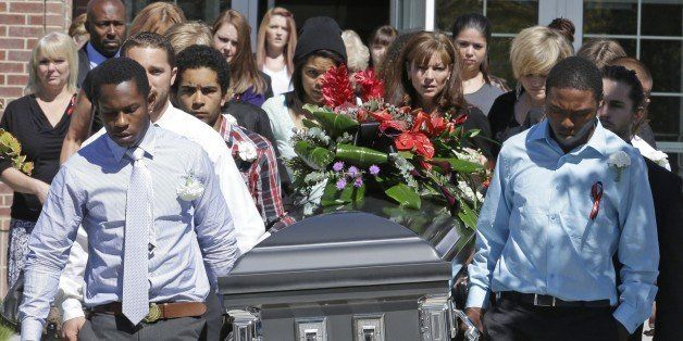 Pallbearers carry the casket of Darrien Hunt following funeral services Thursday, Sept. 18, 2014, in Saratoga Springs, Utah.