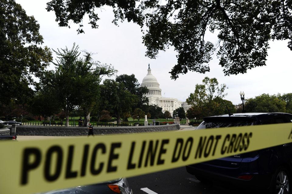 Police cordon off the U.S. Capitol after shots fired were reported near 2nd Street NW and Constitution Avenue on Capitol Hill