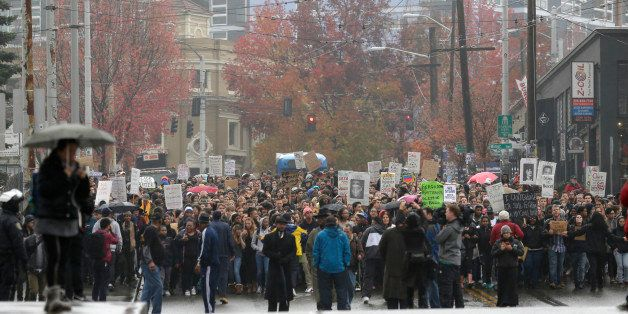 Protesters march in downtown Seattle, Tuesday, Nov. 25, 2014, to demonstrate against a grand jury's decision not to indict po