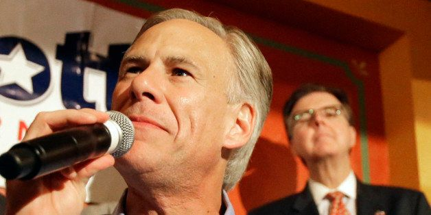 Texas Republican gubernatorial candidate Greg Abbott speaks as Lt. Gov. candidate Dan Patrick, right, looks over his shoulder