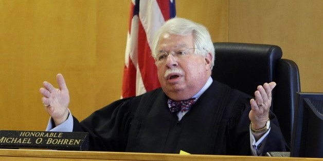 Circuit Judge Michael Bohren presides over the second day of a preliminary hearing in Waukesha, Wis., for two Wisconsin girls