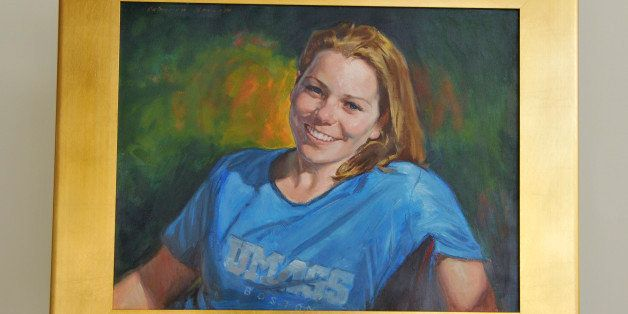 This photo released Thursday, Nov. 21, 2013, by the University of Massachusetts-Boston shows a painting of Boston Marathon bo