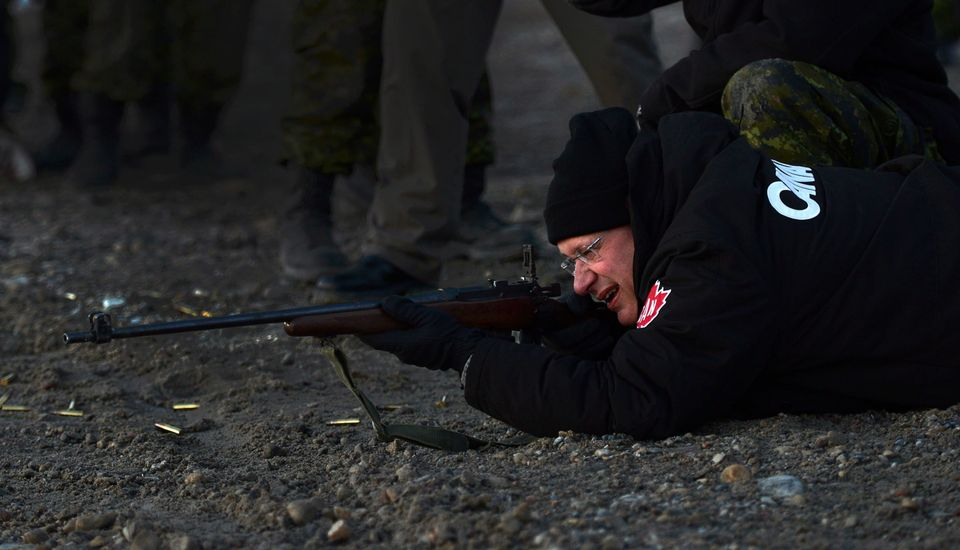 Prime Minister Stephen Harper shoots .303 Lee Enfield rifle in Gjoa Haven, Nunavut on Tuesday, August 20, 2013. The prime min