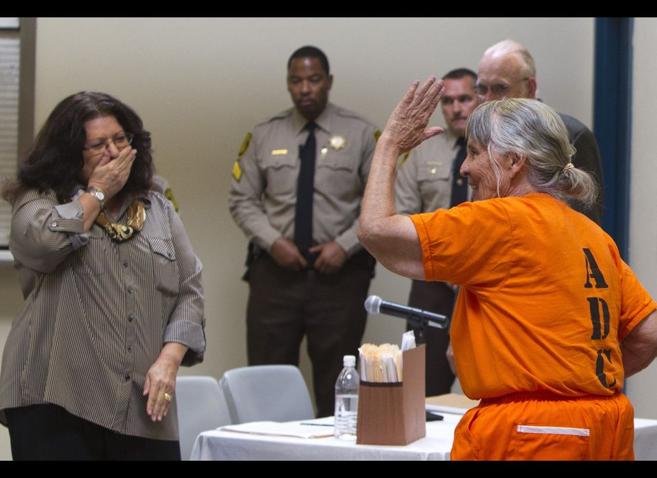 In this photo taken Monday Aug. 13, 2012, Betty Smithey, the country's longest-serving female inmate, reacts with Donna Leone