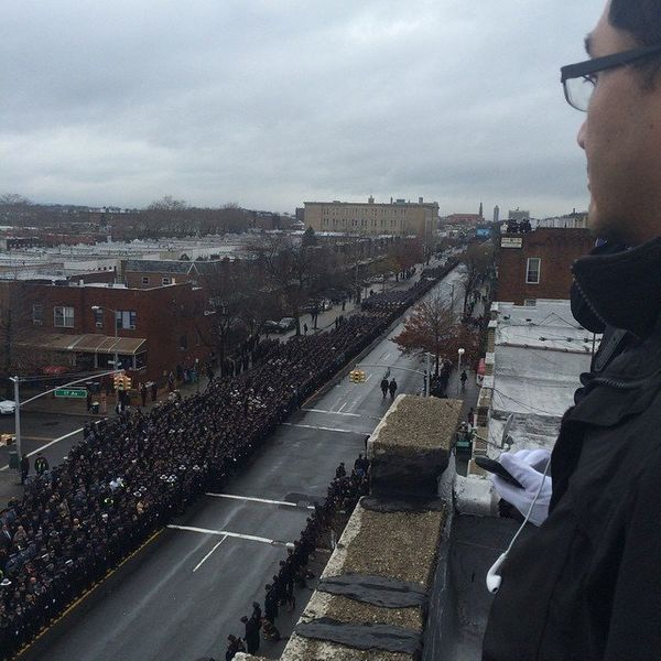 Officers line the street to pay respects to slain NYPD officer Wenjian Liu in Brooklyn on Sunday, Jan. 4, 2015.
