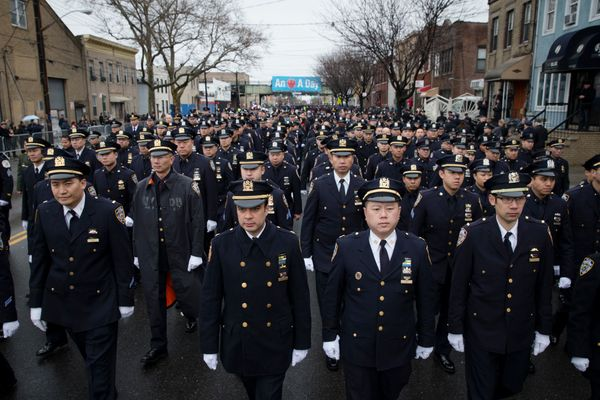 Police officers arrive to the funeral of New York Police Department Officer Wenjian Liu at Aievoli Funeral Home, Sunday, Jan.