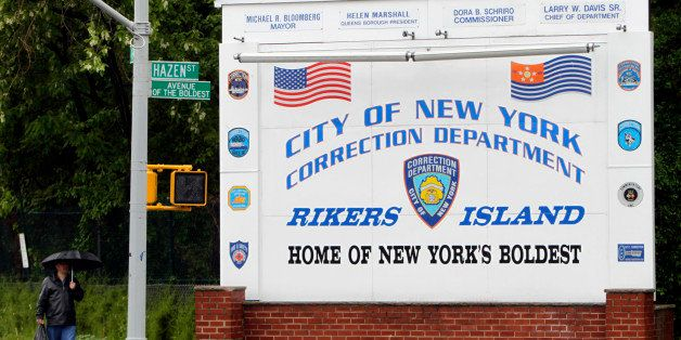 FILE - In this May 17, 2011 file photo, a man walks near the sign at the entrance to the Rikers Island jail in New York. Acco