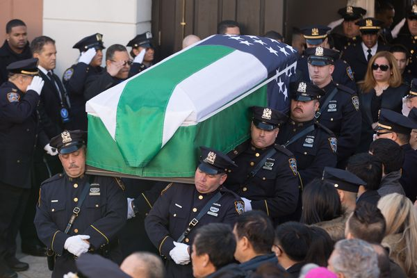 NEW YORK, NY - DECEMBER 27:  Pallbearers carry the casket for the funeral of slain New York Police Department (NYPD) officer