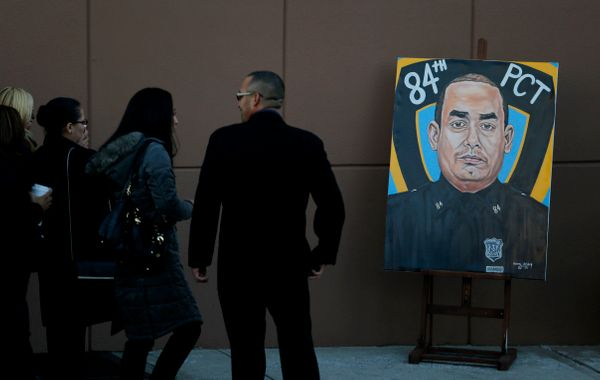 A painting of New York Police Department officer Rafael Ramos is on display outside of Christ Tabernacle Church before his fu