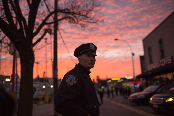 NEW YORK, NY - DECEMBER 27:  An officer directs traffic for the funeral of slain New York City Police Officer Rafael Ramos, o