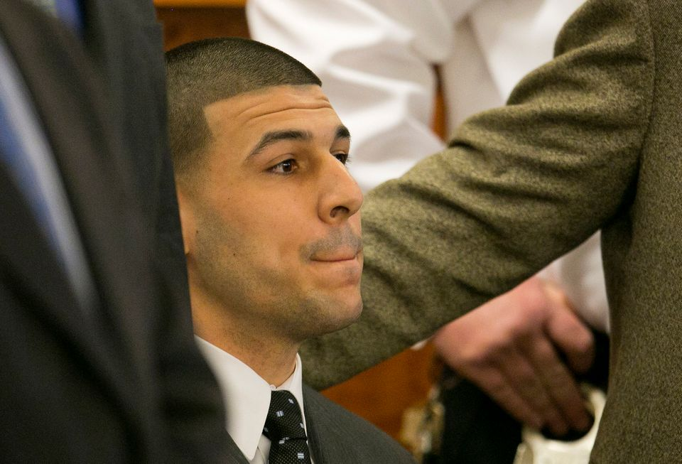Former New England Patriots football player Aaron Hernandez listens as the guilty verdict is read during his murder trial, We