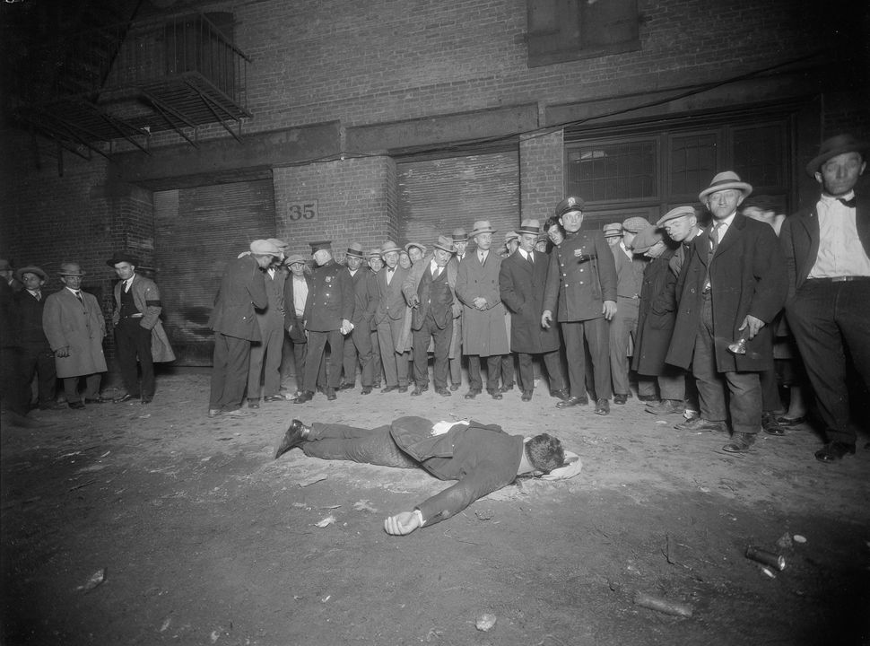 A crowd gathers around the body of Vincenzo Argo who was killed in front of 35 Thompson Street in Manhattan on Oct. 12, 1925.