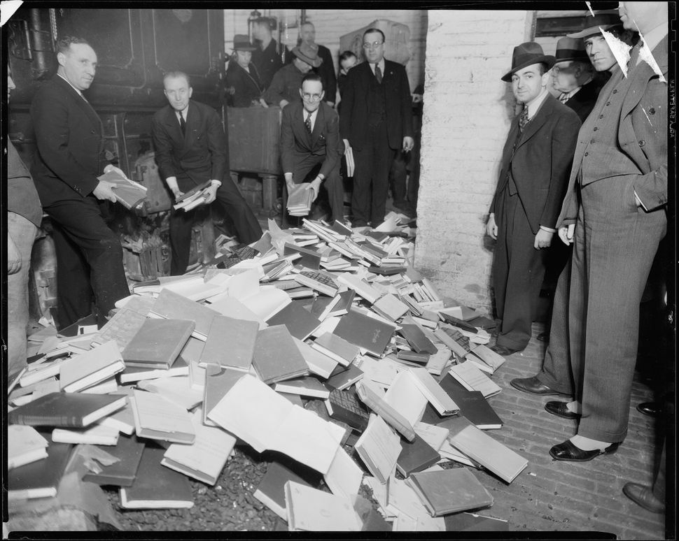 Police destroy books that were thought to be indecent in the furnace room of police headquarters in Manhattan in 1935.