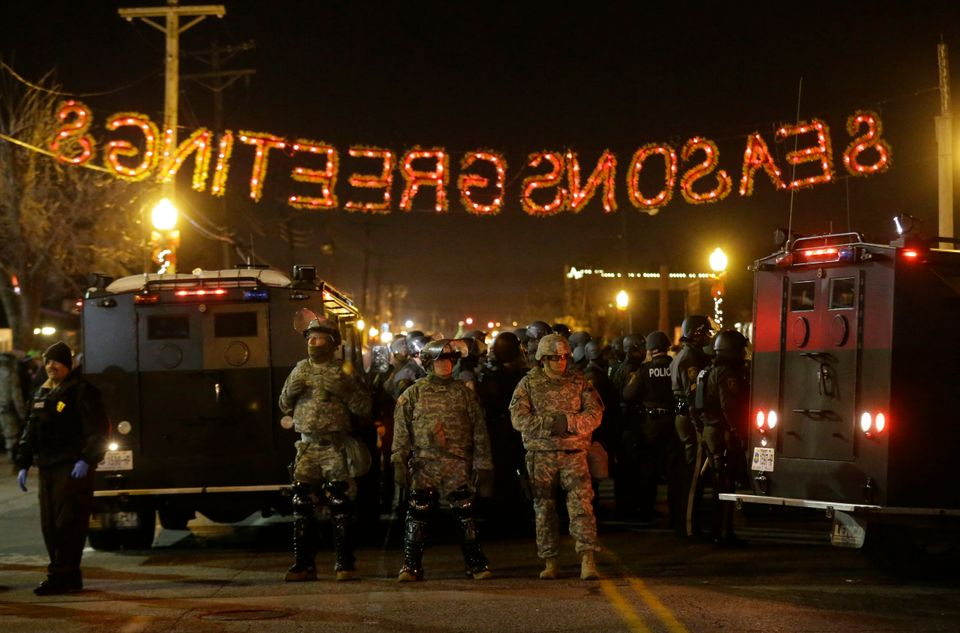 National Guard stand in front of the Ferguson Police Department Tuesday, Nov. 25, 2014, in Ferguson, Mo. Missouri's governor