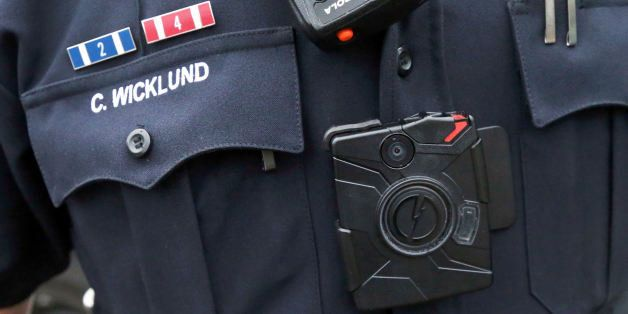In this Nov. 5, 2014 photo, Sgt. Chris Wicklund of the Burnsville Police Department wears a body camera beneath his microphon