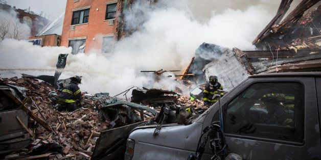 NEW YORK, NY - MARCH 12:  Heavy smoke pours from the debris as the Fire Department of New York (FDNY) responds to a 5-alarm f