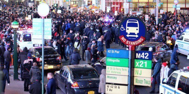 December 4 2015 New York NY Protestors take to the streets in NYC from Times Square to China Town marching, laying on the ground and chanting. Matthew Nelson/MediaPunch/IPX