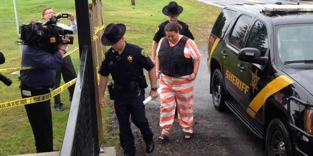 Lawrence County sheriffᅢ까タᅡルs deputies escort Nicole Vaisey to her preliminary hearing Thursday, Aug. 21, 2014, at town cour
