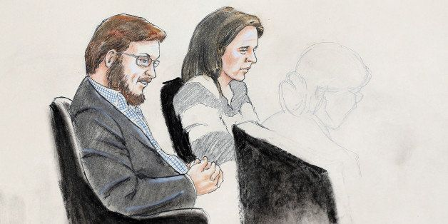 In this courtroom sketch, James Holmes, left, and defense attorney Tamara Brady are depicted, as they sit in court on the fir