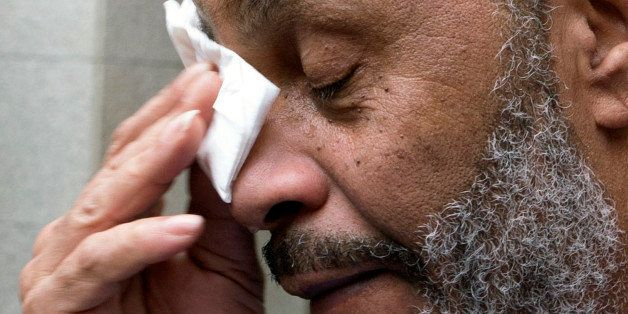 Anthony Ray Hinton wipes away tears after greeting friends and relatives upon leaving the Jefferson County jail, Friday, Apri
