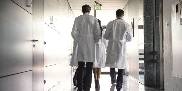 team of doctors walking in hospital hallway