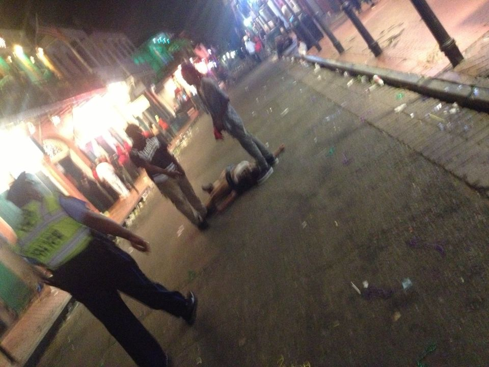 This photo released by David Minsky shows victims being assisted moments after a shooting on Bourbon Street early Sunday morn
