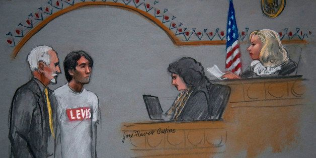 In this courtroom sketch, Khairullozhon Matanov, second from left, with attorney Paul Glickman, left, appears in federal cour